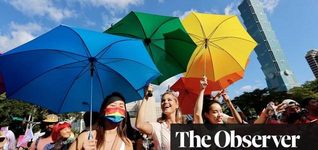 Hugs, sequins and rainbows as Taiwan enjoys victory over virus