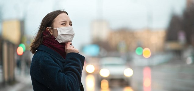 Surgical Mask, Then Cloth? Here's How to Wear Two Masks the Right Way, a Doctor Says